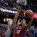 DePaul guard Brandon Young (20) shoots in front of Georgetown forward Nate Lubick (34) during the first half of an NCAA college basketball game, Wednesday, Feb. 20, 2013, in Washington. (AP Photo/Alex Brandon)