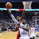 Orlando Magic guard Victor Oladipo (5) shoots past Washington Wizards forward Trevor Booker as Magic's Tobias Harris (12) brings up the rear during the second half of an NBA basketball game in Orlando, Fla., Friday, April 11, 2014. The Wizards won 96-86. (AP Photo/Reinhold Matay)
