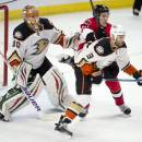 Ottawa Senators right wing Mark Stone clears Anaheim Ducks defenseman Clayton Stoner from in front of goalie Ilya Bryzgalov before scoring during the first period of an NHL hockey game Friday, Dec. 19, 2014, in Ottawa, Ontario. (AP Photo/The Canadian Press, Adrian Wyld)
