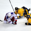 New York Rangers left wing Rick Nash (61), Nashville Predators forward Mike Fisher (12), and Predators defenseman Roman Josi (59), of Switzerland, go down after colliding in the first period of an NHL hockey game on Saturday, Nov. 23, 2013, in Nashville,