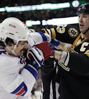 Boston Bruins' Zdeno Chara (33) fights with New York Rangers' Brian Boyle during the second period of an NHL hockey game in Boston, Friday, Nov. 29, 2013. (AP Photo/Winslow Townson)