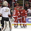 Anaheim Ducks goalie Frederik Andersen (31), of Denmark, stands at the goal as Detroit Red Wings' Luke Glendening is congratulated by teammates Johan Franzen (93), of Sweden, and Justin Abdelkader (8) during the second period of an NHL hockey games Saturd