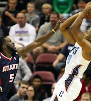 Charlotte Bobcats guard Gerald Henderson, right, takes a jump shot with Atlanta Hawks' DeMarre Carroll during the first half of a preseason NBA basketball game in Asheville, N.C., Tuesday, Oct. 8, 2013. (AP Photo/Adam Jennings)