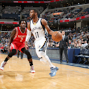 MEMPHIS, TN - NOVEMBER 17: Mike Conley #11 of the Memphis Grizzlies drives to the basket against Patrick Beverley #2 of the Houston Rocketsduring the game on November 17, 2014 at FedExForum in Memphis, Tennessee. (Photo by Joe Murphy/NBAE via Getty Images)