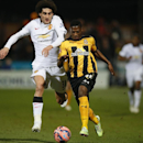 Cambridge United's Sullay Kaikai, right, takes the ball away from Manchester United's Marouane Fellaini during their English FA Cup fourth round soccer match between Cambridge United and Manchester United, in Cambridge, England, Friday, Jan. 23, 2015