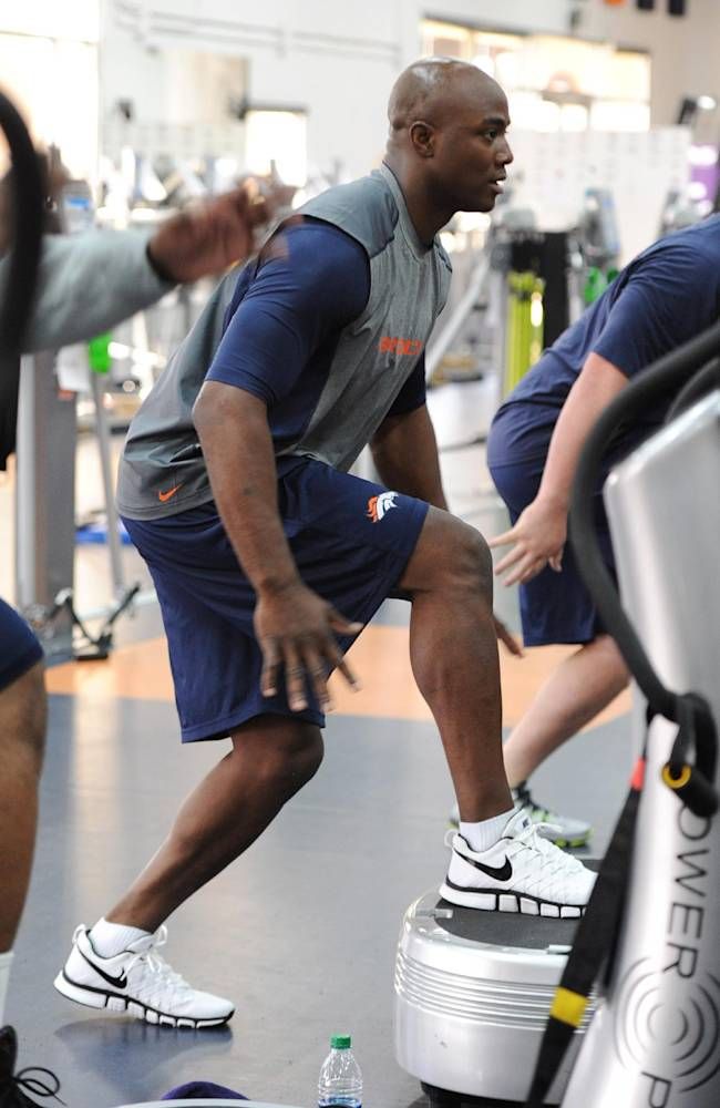 A photo provided by the Denver Broncos is of defensive end DeMarcus Ware working out during the first phase of the offseason training program at the NFL football teams training facility in Englewood, Colo., on Monday, April 21, 2014