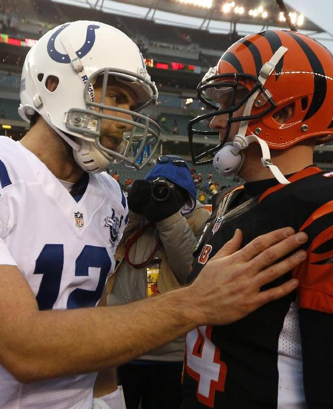 Indianapolis Colts quarterback Andrew Luck (12) meets with Cincinnati Bengals quarterback Andy Dalton (14) after the Bengals defeated the Colts 42-28 in an NFL football game, Sunday, Dec. 8, 2013, in Cincinnati