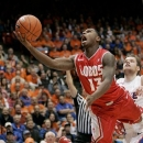 New Mexico's Jamal Fenton (13) drives the lane against Boise State during the first half of an NCAA college basketball game, Wednesday, Jan. 16, 2013, in Boise, Idaho. (AP Photo/Matt Cilley)