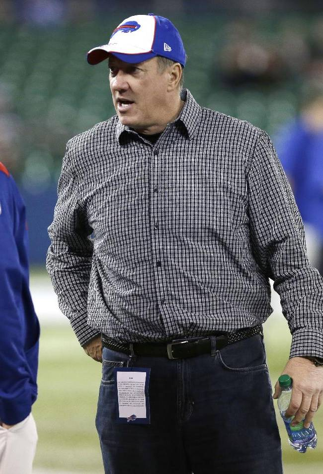 In this Dec. 1, 2013, file photo, Buffalo Bills Hall of Famer Jim Kelly talks on the field before an NFL football game between the Atlanta Falcons and the Bills in Toronto. Kelly's cancer has returned. The Erie County Medical Center in Buffalo said Friday, March 14, 2014, that cancer was found when the former Bills star came in for follow-up testing after having oral surgery to remove cancerous cells last year
