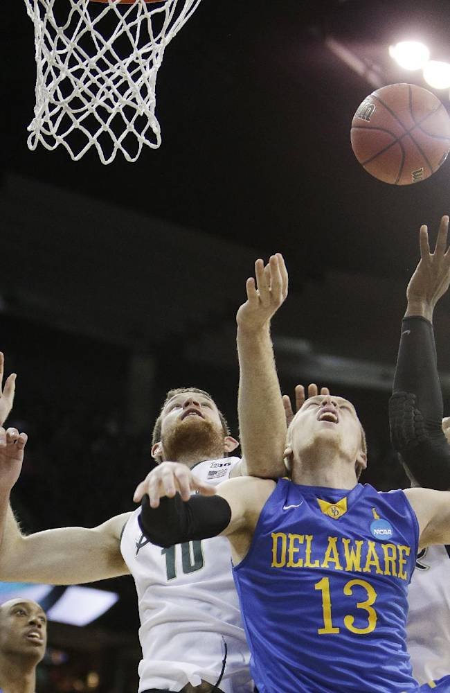 Delaware's Kyle Anderson (13) and Michigan State's Matt Costello (10) fight for a rebound in the first half during the second-round of the NCAA men's college basketball tournament in Spokane, Wash., Thursday, March 20, 2014