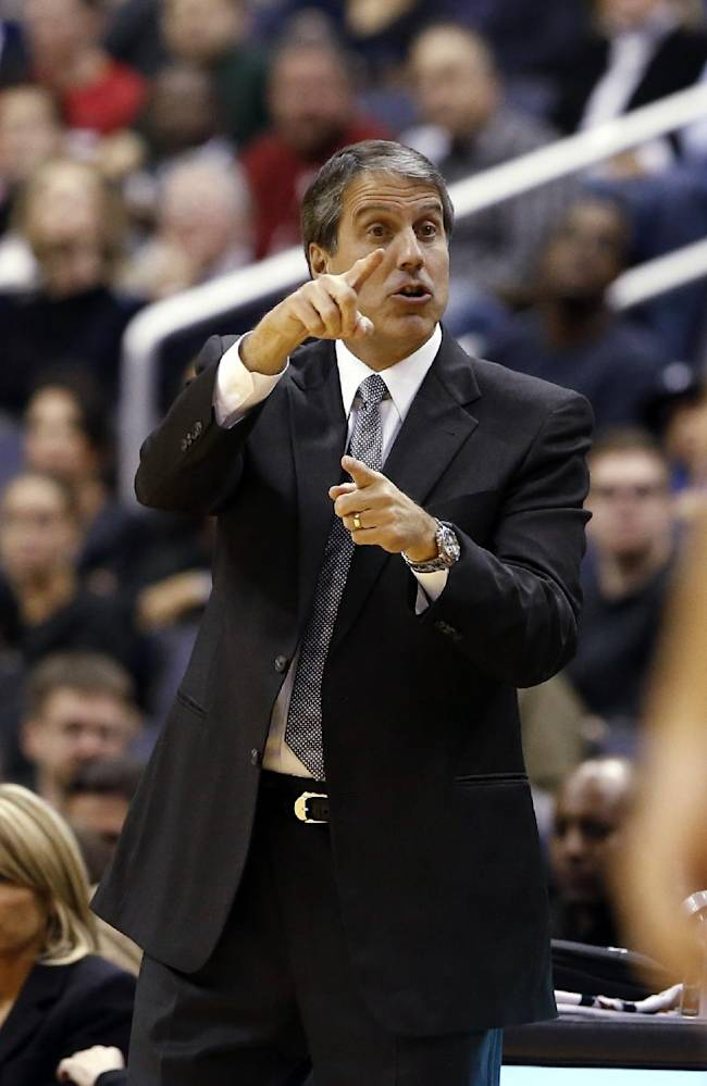 Washington Wizards head coach Randy Wittman directs his team in the first half of an NBA basketball game against the Minnesota Timberwolves Tuesday, Nov. 19, 2013, in Washington. The Wizards won 104-100