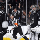 Los Angeles Kings goalie Jonathan Quick, right, celebrates with defenseman Drew Doughty as time runs out in the third period of an NHL hockey game against the Chicago Blackhawks, Wednesday, Jan. 28, 2015, in Los Angeles. The Kings won 4-3 The Associated