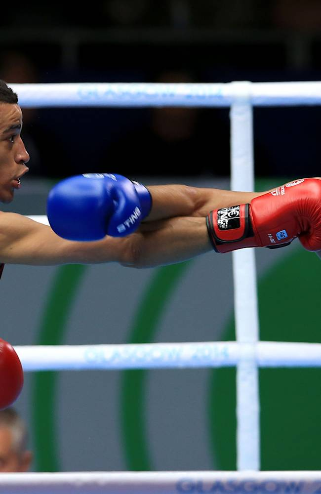 England's Samuel Maxwell in action against India's Manoj Manoj Kumar, right, in the Men's Light Welter Quarter-final match at the SECC, during the 2014 Commonwealth Games in Glasgow, Scotland, Tuesday, July 29, 2014