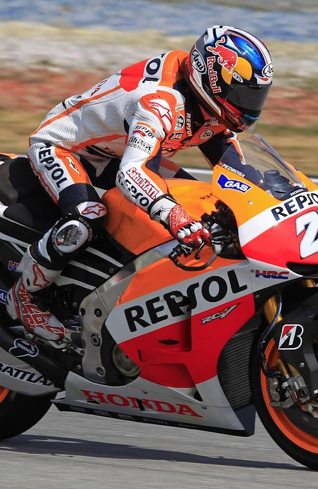 MotoGP rider Dani Pedrosa of Spain steers his Honda during a pre-season test at Sepang International Circuit in Sepang, Malaysia, Tuesday, Feb. 4, 2014