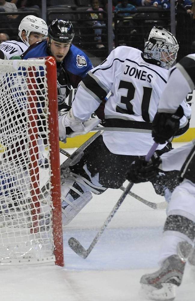 Colorado Avalanche center Ryan O'Reilly (90) scores a game winning shorthanded goal against  Los Angeles Kings goalie Martin Jones (31) during a preseason NHL hockey game on Friday, Sept. 20, 2013, in Denver. Colorado beat Los Angeles 4-3 in overtime