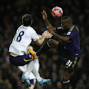 Everton's Gareth Barry, left is fouled by West Ham United's Enner Valencia during their English FA Cup third round replay soccer match between West Ham United and Everton at the Boleyn Ground stadium in London, Tuesday, Jan. 13, 2015