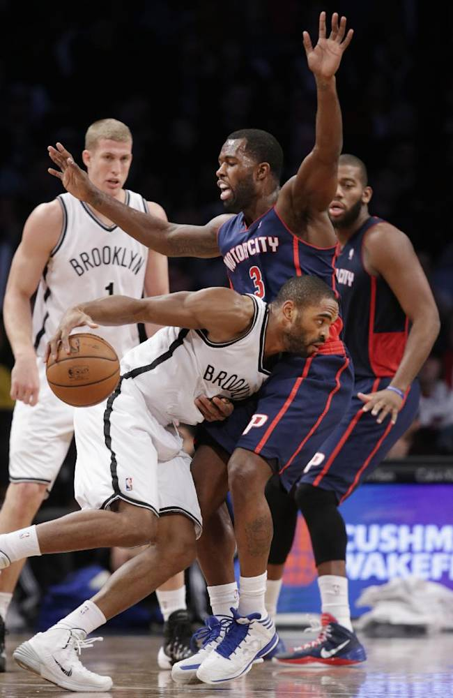 Detroit Pistons guard Rodney Stuckey (3) defends as Brooklyn Nets' Alan Anderson (6) tries to drive to the basket in the second half of an NBA basketball game, Sunday, Nov. 24, 2013, in New York. The Pistons won 109-97