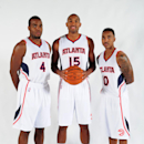 ATLANTA, GA - SEPTEMBER 29: Paul Millsap #4, Al Horford #15, and Jeff Teague #0 of the Atlanta Hawks pose for a photograph during the Atlanta Hawks Media Day on September 29, 2014 at Philips Arena in Atlanta, Georgia. (Photo by Scott Cunningham/NBAE via Getty Images)