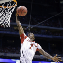Louisville guard Russ Smith (2) goes up with a layup past Duke's Mason Plumlee (5) during the first half of the Midwest Regional final in the NCAA college basketball tournament, Sunday, March 31, 2013, in Indianapolis. (AP Photo/Michael Conroy)