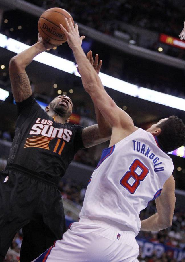 Phoenix Suns forward Markieff Morris (11) shoots over Los Angeles Clippers forward Hedo Turkoglu (8), of Turkey during the second half of an NBA basketball game Monday, March 10, 2014, in Los Angeles. Clippers won 112-105