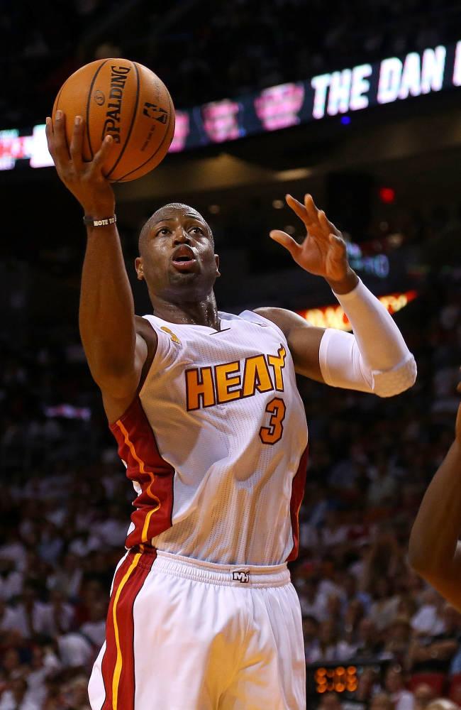 Heat rest Dwyane Wade because of sore knees