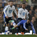Chelsea's Eden Hazard, right lower, is tackled by Tottenham Hotspur's Kyle Walker, right top, during their English Premier League soccer match at Stamford Bridge, London, Saturday, March 8, 2014