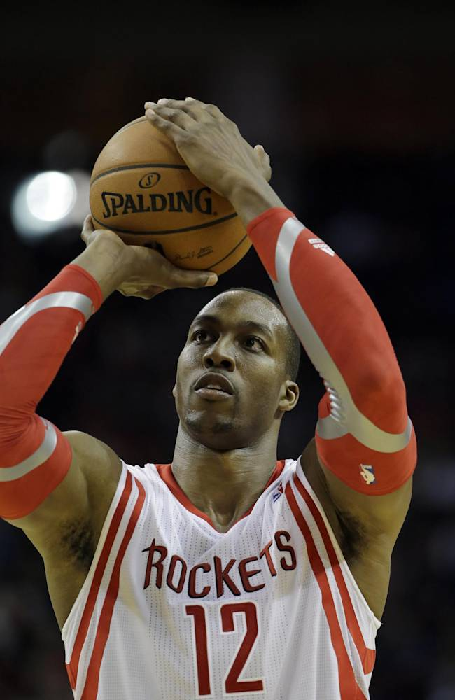 Houston Rockets' Dwight Howard shoot a free throw against the Los Angeles Lakers during the fourth quarter of an NBA basketball game Thursday, Nov. 7, 2013, in Houston. Howard made five of his 16 free throw attempts. The lakers won 99-98