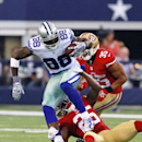 Dallas Cowboys wide receiver Dez Bryant (88) is tackeld by San Francisco 49ers strong safety Jimmie Ward (25) as 49ers free safety Eric Reid approaches during the second half of an NFL football game Sunday, Sept. 7, 2014, in Arlington, Texas The Associat