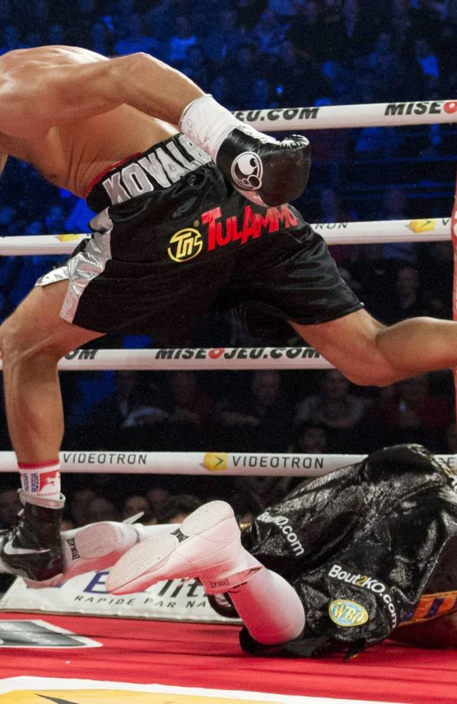 Sergey Kovalev leaps over Ismayl Sillakh after knocking him out during the WBO light heavyweight title fight in Quebec City on Saturday, Nov. 30, 2013