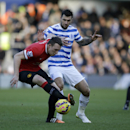 Queens Park Rangers' Charlie Austin, right, competes for the ball with Manchester United's Phil Jones, during the English Premier League soccer match between QPR and Manchester United at Loftus Road stadium in London, Saturday, Jan. 17, 2015
