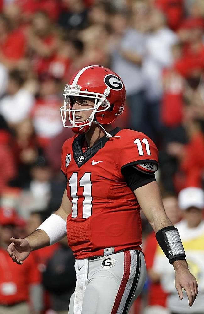Georgia quarterback Aaron Murray walks off the field after throwing his second touchdown in the first half of an NCAA college football game against Appalachian State, Saturday, Nov. 9, 2013, in Athens, Ga