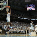 North Carolina's James Michael McAdoo (43) dunks above Shaw's Taurus Dortch during the first of an NCAA preseason college basketball game on Friday, Oct. 26, 2012, in Chapel Hill, N.C. (AP Photo/Ted Richardson)