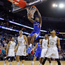 Los Angeles Clippers center DeAndre Jordan (6) dunks the ball over New Orleans Pelicans's Eric Gordon (10), Greg Stiemsma (34), Al-Farouq Aminu (0) and Anthony Davis (23) in the first half of an NBA basketball in New Orleans, Monday, Feb. 24, 2014 The As