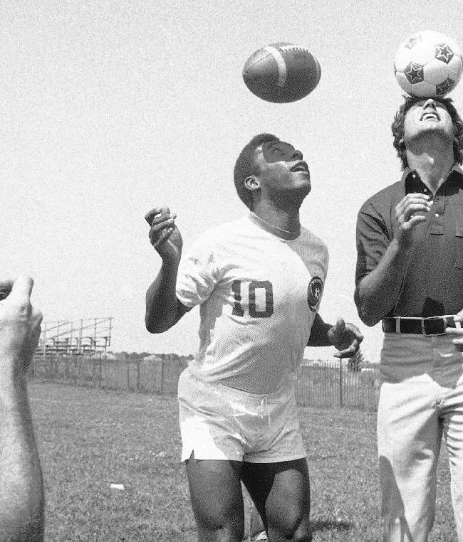In this Aug. 5, 1975, file photo, New York Jets quarterback Joe Namath, right, bounces soccer ball on his head while Pele, of the New York Cosmos, uses his head to get a feel for the pigskin at the Jets' training camp at Hofstra University in Hempstead, N.Y. Pele, who has had an interest in the NFL since his Cosmos days in the 1970s, will appear in a commercial during Sunday night's game for Subway as their latest
