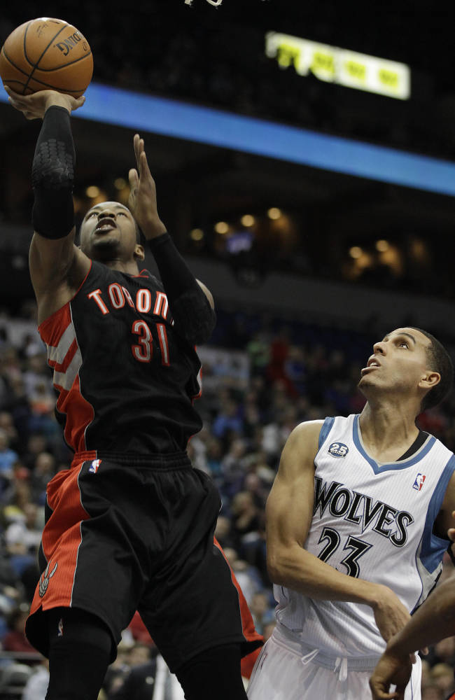 Toronto Raptors forward Terrence Ross (31) goes up to the basket past Minnesota Timberwolves guard Kevin Martin (23) in the first half of an NBA basketball game, Sunday, March 9, 2014, in Minneapolis. The Raptors won 111-104