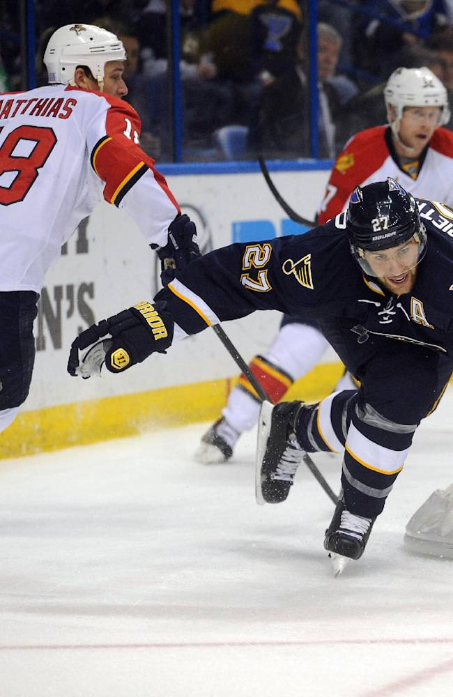 St. Louis Blues' Alex Pietrangelo (27) reaches for the puck in front of Florida Panthers' Shawn Matthias (18) during the first period of an NHL hockey game Saturday, Oct. 5, 2013, in St. Louis