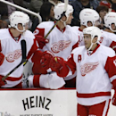 Detroit Red Wings' Pavel Datsyuk (13) celebrates with teammates as he returns to the bench after scoring during the second period of a NHL pre-season hockey game against the Pittsburgh Penguins in Pittsburgh Monday, Sept. 22,