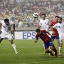 Uzbekistan's Shorakhmedov Akmal, left, scores an own goal against South Korea during their Asian zone Group A qualifying soccer match for the 2014 World Cup at Seoul World Cup stadium in Seoul, South Korea Tuesday, June 11, 2013. (AP Photo/Lee Jin-man)
