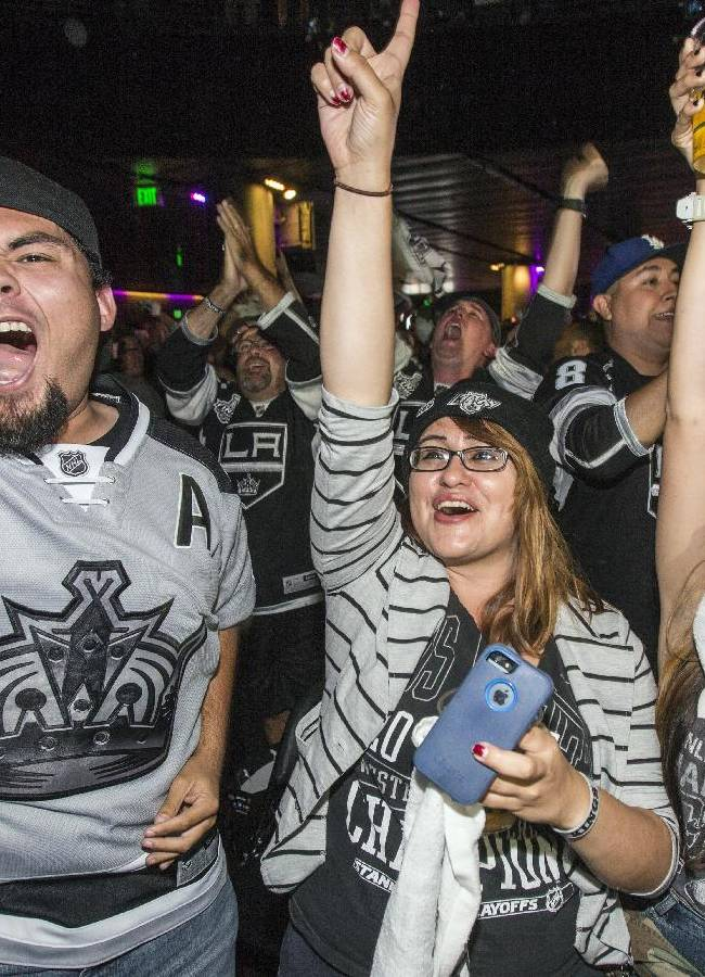 Los Angeles Kings fans celebrate during a watch party at Club Nokia at L.A. LIVE after the Kings scored in second period during Game 4 of the NHL hockey Stanley Cup Finals against the New York Rangers, Wednesday, June 11, 2014, in Los Angeles