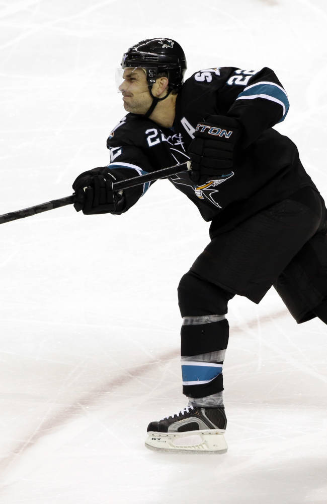 In this Jan. 2, 2014 file photo, San Jose Sharks' Dan Boyle (22) shoots against the Edmonton Oilers during an NHL hockey game in San Jose, Calif. NHL teams can begin making deals with free agents Tuesday, July 1, 2014