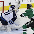 Winnipeg Jets goalie Ondrej Pavelec (31) makes a save against Dallas Stars center Tyler Seguin (91) during the third period of an NHL hockey game Thursday, Jan. 15, 2015, in Dallas. The Jets won 2-1 The Associated Press