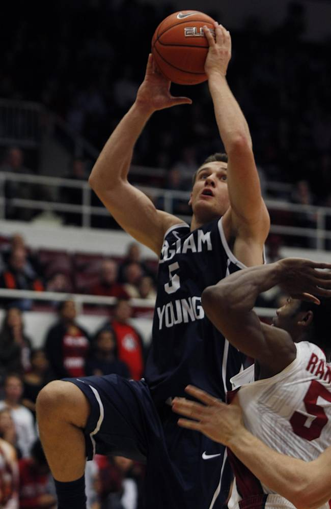 Brigham Young's  Kyle Collinsworth shoots over Stanford's Chasson Randle during the first half of an NCAA college basketball game, Monday, Nov. 11, 2013, in Stanford, Calif