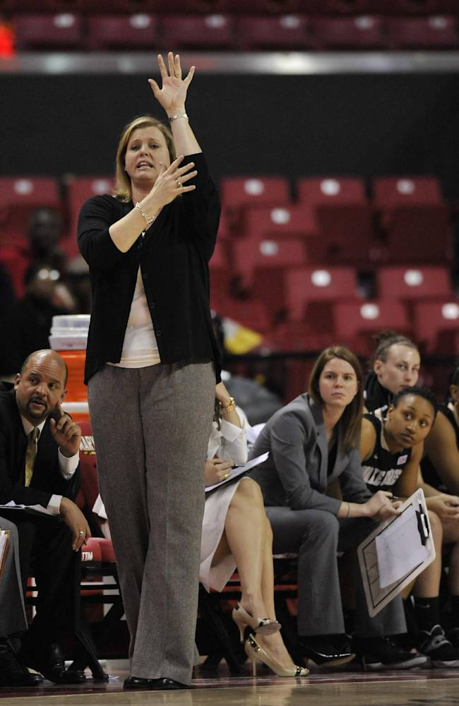 Wake Forest head coach Jen Hoover signals her team in the second half of an NCAA college basketball game against Maryland, Thursday, Jan 9, 2014, in College Park, Md. Maryland won 76-49