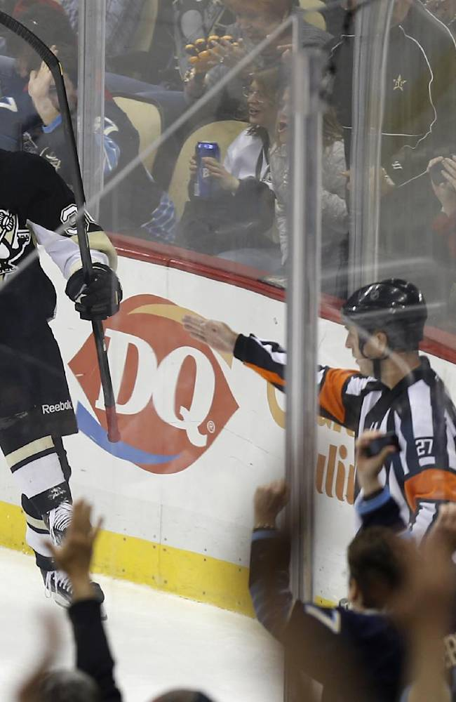 Pittsburgh Penguins' Jussi Jokinen, of Finland, celebrates after scoring against the Washington Capitals during the first period of an NHL hockey game, Tuesday, March 11, 2014, in Pittsburgh