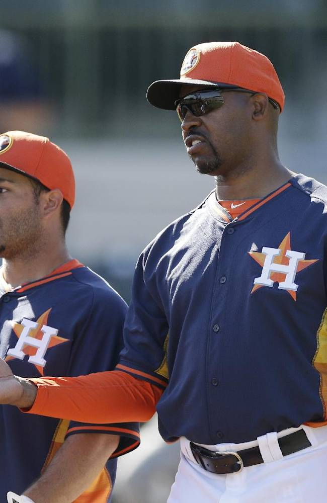Houston Astros manager Bo Porter, right, talks with Jose Altuve before a spring training baseball game against the Toronto Blue Jays in Kissimmee, Fla., Sunday, March 9, 2014