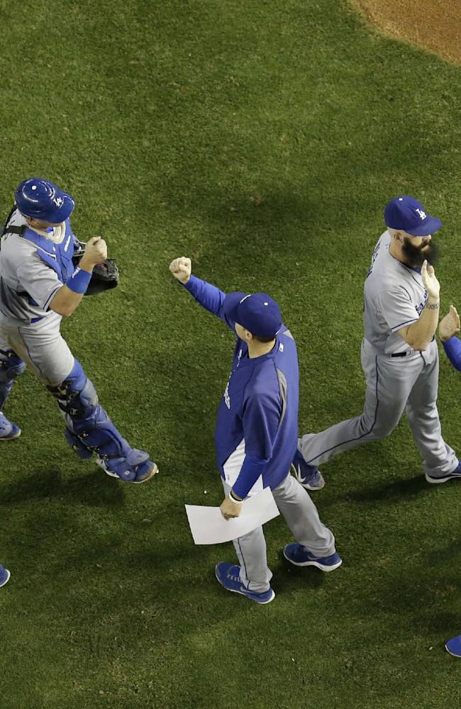 The Los Angeles Dodgers celebrate after a baseball game against the Arizona Diamondbacks on Friday, May 16, 2014, in Phoenix. The Dodgers won 7-0
