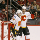 Calgary Flames' Jiri Hudler (24), of the Czech Republic, and T.J. Brodie celebrate Brodie's second period goal against the Arizona Coyotes during an NHL game Saturday, Nov. 29, 2014 in Glendale, Ariz The Associated Press
