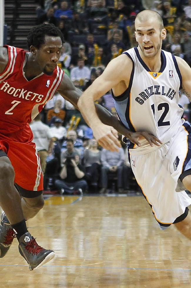 Memphis Grizzlies guard Nick Calathes (12) drives to the basket against Houston Rockets guard Patrick Beverley (2) in the second half of an NBA basketball game Saturday, Jan. 25, 2014, in Memphis, Tenn. The Grizzlies won 99-81