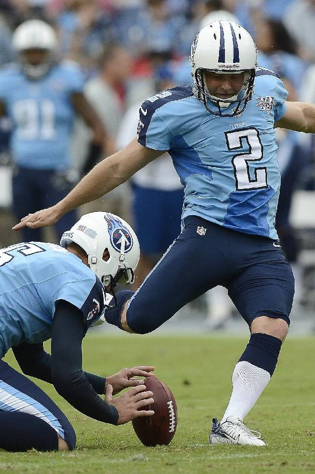 In this Sept. 29, 2013 file photo, Tennessee Titans kicker Rob Bironas (2) kicks a 26-yard field goal against the New York Jets in the first quarter of an NFL football game in Nashville, Tenn. Holding is Brett Kern (6). The Titans announced Wednesday, March 19, 2014, that they have waived Bironas