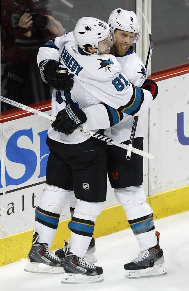 San Jose Sharks right wing Tyler Kennedy (81) and center Joe Pavelski celebrate after Pavelsk scored against the Chicago Blackhawks during the second period of an NHL hockey game on Sunday, Nov. 17, 2013, in Chicago